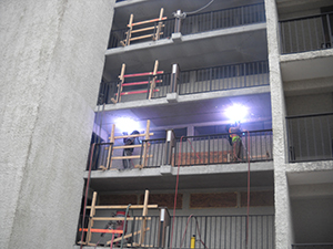 Thermal spray cathodic protection being applied to walkway hollow-core panels with contamination but limited distress